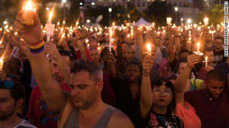 Hundreds of people hold candles at a memorial after the Pulse Nightclub shooting in Orlando, Florida.