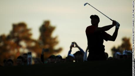Tiger Woods plays his second shot on the 18th hole during The Match.