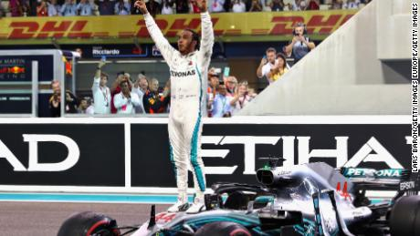 Race winner Lewis Hamilton of Great Britain and Mercedes celebrates after his 11th win of the season.