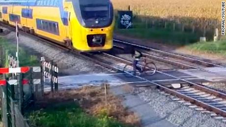 Cyclist Avoids Train With No Room To Spare Video Shows A Cyclist In The Netherlands Narrowly Avoiding An Oncoming
