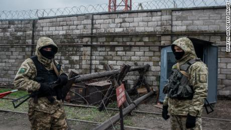 Ukrainian sea border security soldiers man a checkpoint at the Mariupol Port on Wednesday.