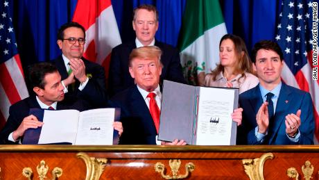 Mexico's President Enrique Pena Nieto (L) US President Donald Trump (C) and Canadian Prime Minister Justin Trudeau, sign a new free trade agreement in Buenos Aires, on November 30, 2018, on the sidelines of the G20 Leaders' Summit. - The revamped accord, called the US-Mexico-Canada Agreement (USMCA), looks a lot like the one it replaces. But enough has been tweaked for Trump to declare victory on behalf of the US workers he claims were cheated by NAFTA. (Photo by SAUL LOEB / AFP)        (Photo credit should read SAUL LOEB/AFP/Getty Images)