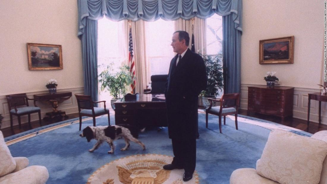 Bush takes a last look around the Oval Office with his dog, Ranger, before vacating the White House for Bill Clinton.