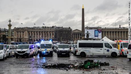 Dozens of ambulances block the Place de la Concorde square and bridge leading to the French National Assembly during a protest of ambulances owner and drivers on December 3, 2018, against their working conditions and for the withdrawal of the newly voted article 80 of the finance act on social security. (Photo by Thomas SAMSON / AFP)        (Photo credit should read THOMAS SAMSON/AFP/Getty Images)