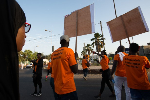 Demonstrators march to end violence against women in central Dakar on Sunday, December 9.