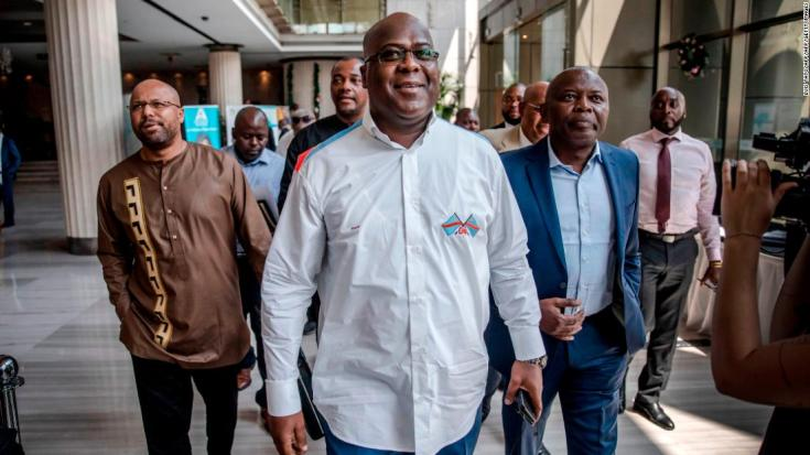 Presidential candidate Felix Tshisekedi (C) arrives for a meeting between CENI, SADC and other presidential candidates in Kinshasa on December 29, 2018, one day ahead of the general elections. (Photo by Luis TATO / AFP) (Photo credit should read LUIS TATO/AFP/Getty Images)
