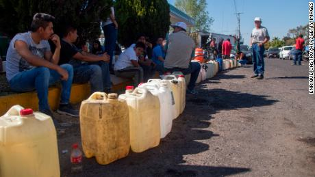 People buy gas in Michoacán, one of several Mexican states where shortages have been reported.