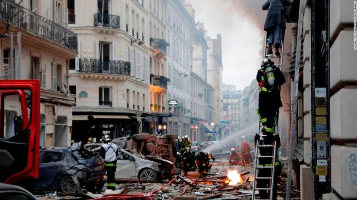 A woman is evacuated by firefighters from an apartment after the explosion of a bakery on the corner of the streets Saint-Cecile and Rue de Trevise in central Paris on January 12, 2019. - A large explosion badly damaged a bakery in central Paris, injuring several people and smashing windows in surrounding buildings, police and AFP journalists at the scene said. A fire broke out after the blast at around 9am (0800 GMT) in the busy 9th district of the city, which police suspect may have been caused by a gas leak. (Photo by Thomas SAMSON / AFP) (Photo credit should read THOMAS SAMSON/AFP/Getty Images)
