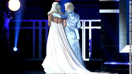 Co-winners Lady Gaga (L) and Glenn Close exit the stage together after accepting the award for best actress.