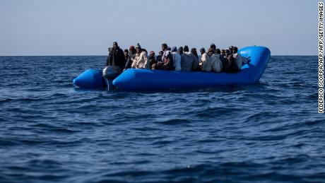 An unflatable boat with 47 migrants on board is pictured while being rescued by the Dutch-flagged Sea Watch 3 off Libya's coasts on January 19, 2019.