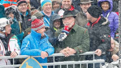 Arnold Schwarzenegger soaks up the atmosphere in Kitzbuhel.