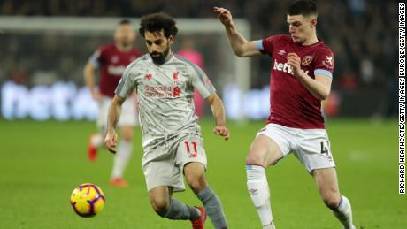 Salah battles for possession with West Ham's Declan Rice.