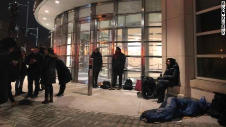 People wait outside the courthouse at 5 a.m. on February 5, the second day of deliberations.