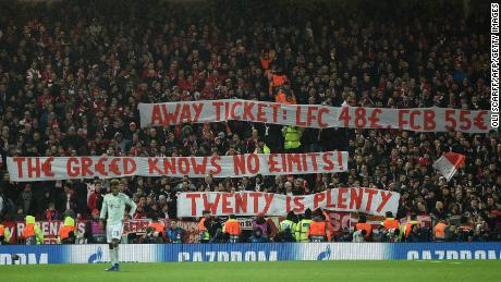 Bayern fans hold aloft banners complaining at ticket prices during its game at Anfield.