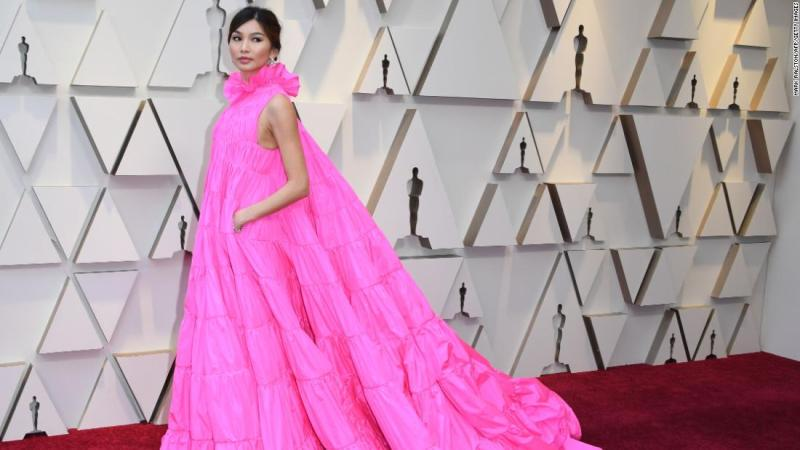 """The """"Crazy Rich Asians"""" star, consistently among the best-dressed during this year's awards season, wore a voluminous pink, high-collared dress by Valentino."""