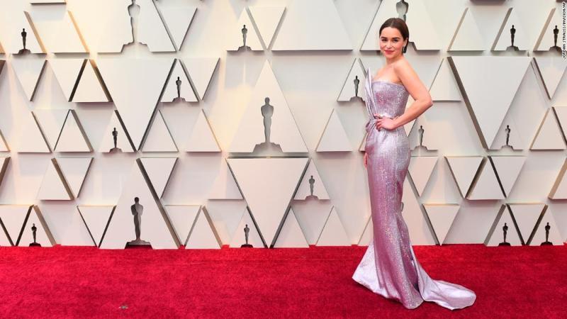 Award presenter Emilia Clarke wore a strapless, sparkly lilac gown custom-made by Balmain, while debuting a sleek new bob.