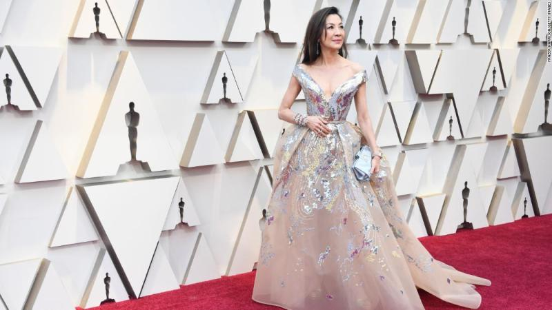 """The """"Crazy Rich Asians"""" star has worn Elie Saab to numerous red carpets this year. This time, she paired a shimmery, off-shoulder gown with a showstopping bracelet by Chopard and watch by Richard Mille."""