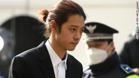 K-pop star Jung Joon-young arrives for questioning at the Seoul Metropolitan Police Agency in Seoul on March 14, 2019.