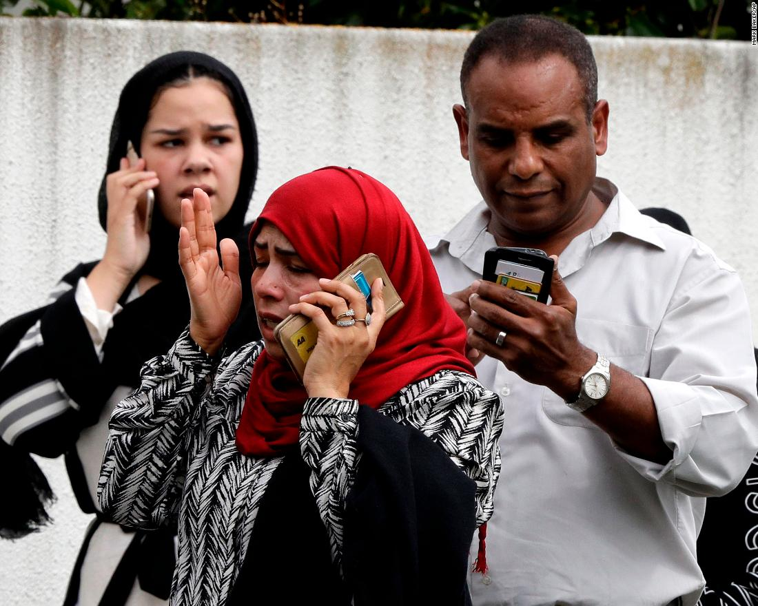 People talk on their phones after the attacks.