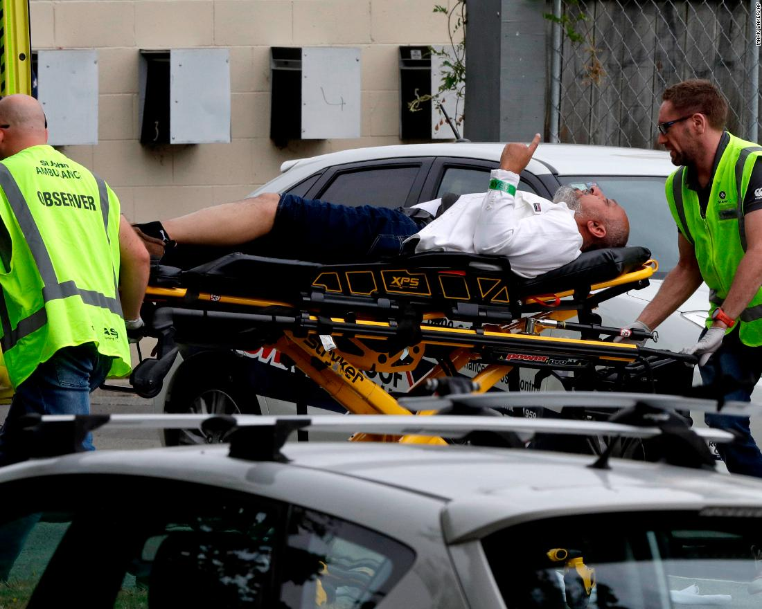 Paramedics load an injured man into an ambulance in Christchurch, New Zealand, on Friday, March 15.