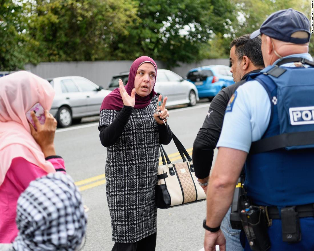 Members of the public react in front of the al Noor mosque after the attack.