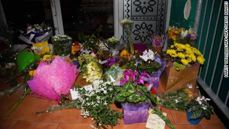 Flowers are placed on the front steps of the Wellington mosque.