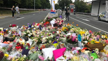 Tributes laid at the police line close to the Al Noor mosque in Christchurch where 41 people died.