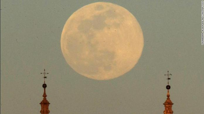 A view of the full moon that announces the start of the spring over the Santiago de Compostela Cathedral in Galicia, Spain on March 20.