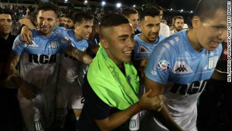 Racing Club players celebrate just the club's third league title since 1966.