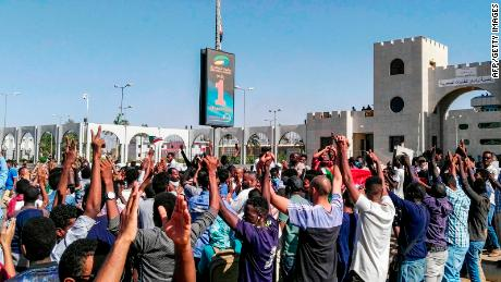 Demonstrators in the presidential compound in the capital Khartoum.