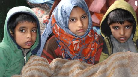Babur Ali's children now live in temporary housing near Srinagar.