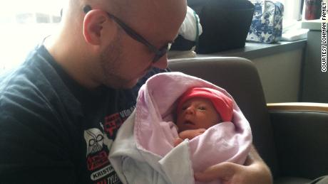 Eric Lohman holds Rosie in the hospital in August 2012.