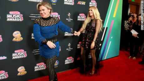 Kelly Clarkson and Carrie Underwood at an event in 2018