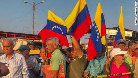 Current and former workers of Venezuelan state oil company PDVSA protest outside of the Las Salinas oil field.
