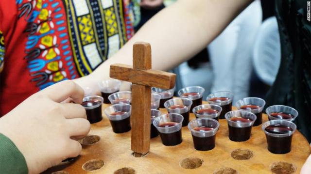 The congregation is offered grape juice during Communion at the Bread of Life.