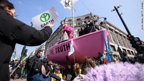 A pink sailboat with the message 'Tell the truth' blocks Oxford Circus.
