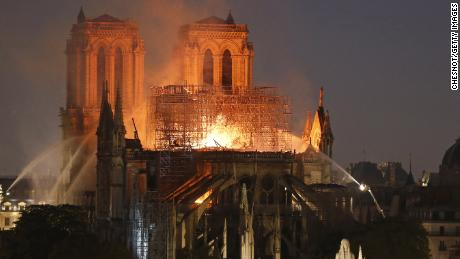 Fire caused Notre Dame's spire to collapse as people watched on horrified.