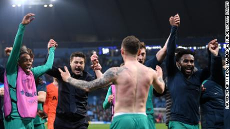 Mauricio Pochettino celebrated wildly with his players at full time.