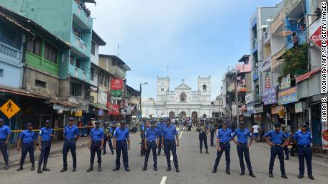 Sri Lankan security personnel keep watch outside a church in Colombo after a blast Sunday.