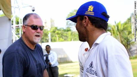 Gatting (left) shakes hands with a member of the Afghan team after their match in 2006. The former England captain was dismissed for a duck.