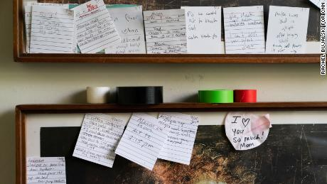 Notes posted outside Whitney's bedroom door offer reminders about his treatment.
