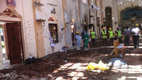 In the days after the bombing, forensic experts sift through the aftermath at St Sebastian's Church.