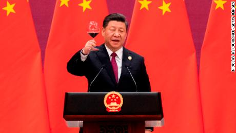 China's President Xi Jinping raises his glass and proposes a toast at the Great Hall of the People in Beijing on April 26.
