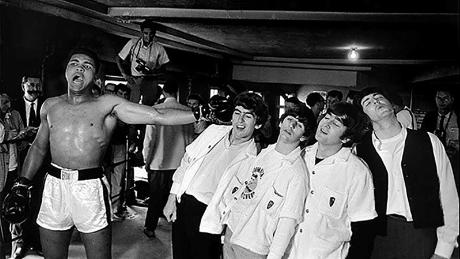 Ali poses with the Beatles in 1964.