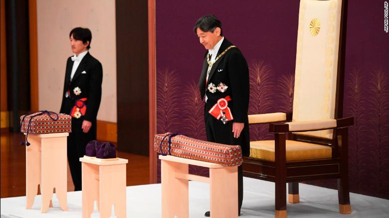 Japan's new Emperor Naruhito receives the Imperial regalia of sword and jewel as proof of succession at the ceremony at Imperial Palace in Tokyo, Wednesday, May 1, 2019. Standing at left is Crown Prince Akishino.