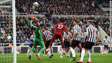 Divock Origi heads home his side's winner in the 3-2 victory at Newcastle.