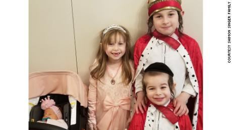 From left, Malky, Gitty, Menachem and Dovi Singer dressed up for the Jewish holiday of Purim in March. They live in Monsey, New York, where there's been a measles outbreak since last fall.