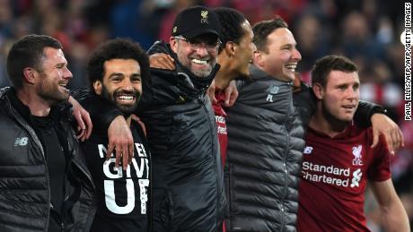 Mohamed Salah, Jurgen Klopp and Virgil van Dijk celebrate after Liverpool's remarkable win.