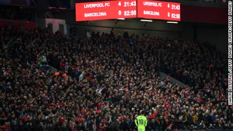 Messi looks dejected as the scoreboard reads '4-0' at Anfield.