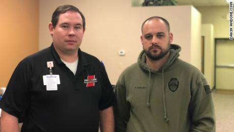 Dr. Hudson Garrett, left, and Officer Travis Darley pose for a picture after instructing a Stop the Bleed class on May 11, 2019.